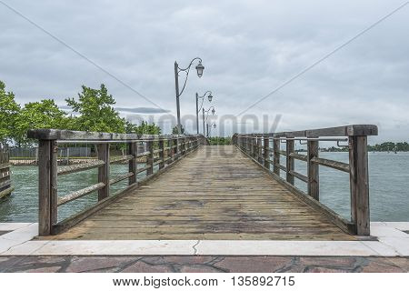 Wooden Old Bridge At Burano, An Island Nearby Venice, Italy