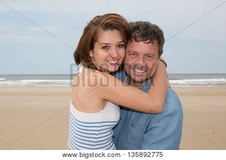 Cheerful Couple Laughing Together At The Beach