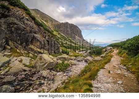 Hiking Trail near a Creek. Mountain Landscape on Cloudy Day. Mlynicka Valley High Tatra Slovakia.