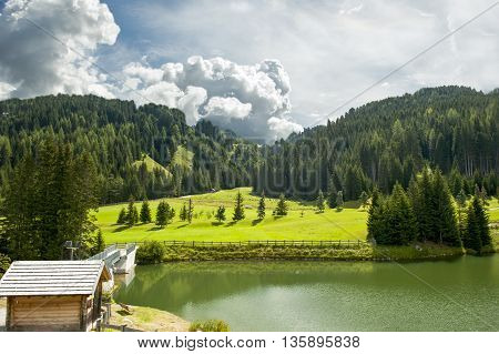the small alpine lake of the Italian Dolomites