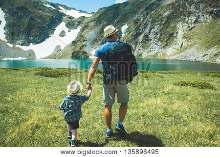 Father and his son near the Seven lakes in Rila mountain, Bulgaria