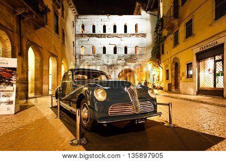 Verona Italy - May 07 2016: The retro car of Fiat nearby the Borsari gate at evening time