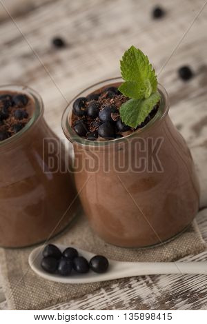 Healthy breakfast or morning snack with chia seeds chocolate pudding and blueberries. vegetarian food diet and health concept.