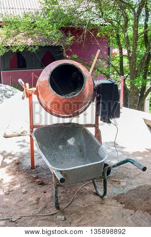 photo of a cement mixer and cart