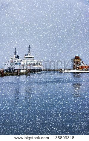 HELSINGBORG SWEDEN - JANUARY 14 2016: A ferry comes into the seaport of Helsingborg in Sweden from Helsingor in denmark on a cold winters day.