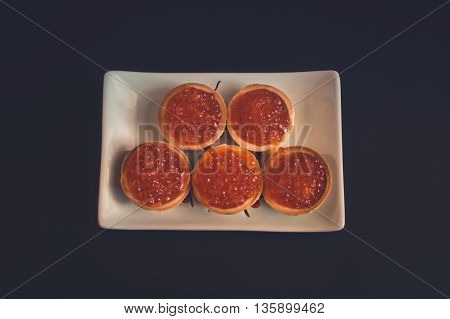 Vintage style: Plate with russian red caviar tartlets