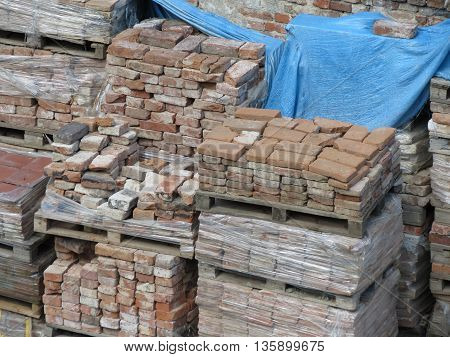 Pile or pallet of red bricks for construction