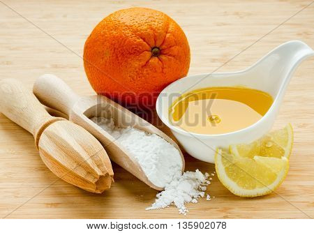 Sugar syrup with orange juice ingredient for impregnating biscuit cake selective focus