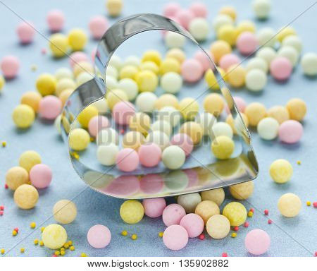 Heart shape and beautiful colorful confectionery sugar sprinkling pearl bubble selective focus