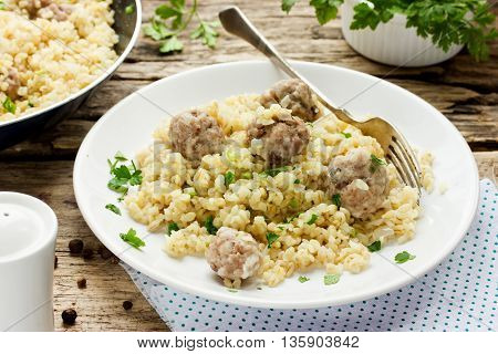 Bulgur with beef meat balls and spices in rustic style traditional Turkish cuisine