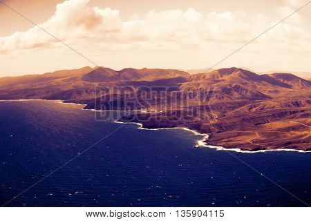 Canary Islands from the aircraft.  Toned image