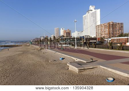 Many Unknown People Stroll  On  Morning Beach Front Promenade