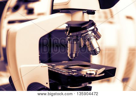 Laboratory microscope.  Toned image