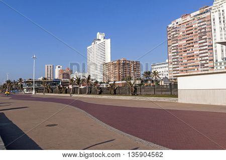 Beach Front Paved Promenade And  City Skyline