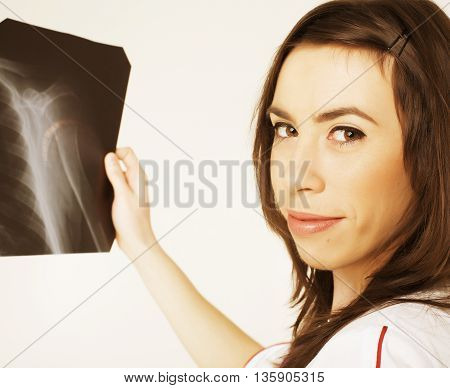 young pretty woman doctor with stethoscope close up, holding x-ray wearing uniform, confident real people professional concept