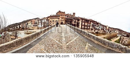 Valderrobres Spain- March 25 2016: Panorama of San Roque bridge in the Valderrobres village. Valderrobres known as one of the most beautiful village in Spain. Province of Teruel