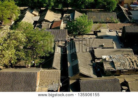 Beijing China - May 1 2005: View over the tiled rooftops of the Wang Fu Jing Hutong in the center of the city