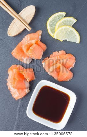 Smoked salmon filet with soy sauce on gray stone vertical