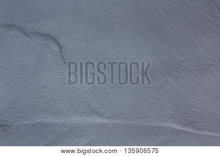 Natural gray slate stone texture background and wallpaper