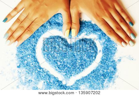 manicure with blue nails and seasalt close up like heart, love for summer