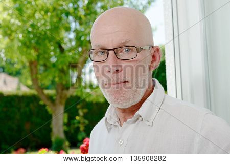 a portrait of a middle-aged man in home