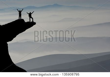 summit of misty mountains.mountaineering activities.Success concept for mountaineer.