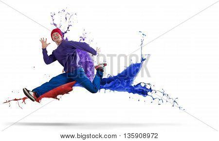 Young man hip hop dancer jumping high