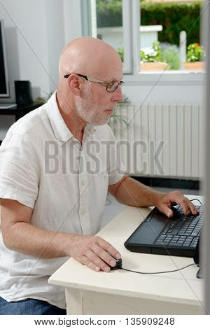 a portrait of a middle age man with laptop