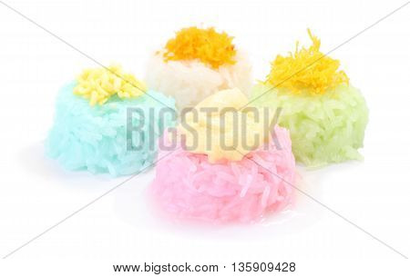 Multiple color of sticky rice with custard on white floor.