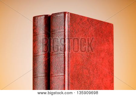 Education concept with red cover books