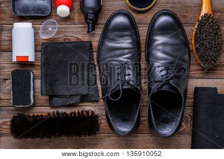 Shoe wax, brush and boot