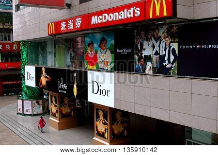 Chengdu China - April 12, 2008: Christian Dior Boutique and a McDonald's fast food restaurant at a midtown shopping center