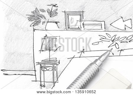 Designer Hand Drawing Of Bedroom Furniture With Pencil And Eraser