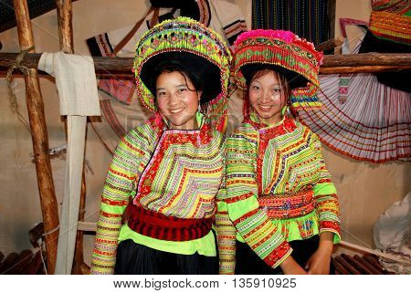 Chengdu China - May 28 2007: Two women modelling traditional Li Su clothing in Panzhihua Hall at the 1st International Festival of the Intangible Cultural Heritage Exposition