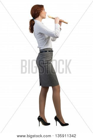Cheerful businesswoman playing fife isolated on white background