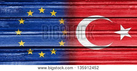 Image relative to politic relationships between European Union and Turkey. National flags textured by wood.