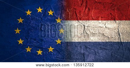 Image relative to politic relationships between European Union and Netherlands. National flags textured by concrete