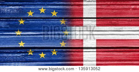 Image relative to politic relationships between European Union and Denmark. National flags textured by wood