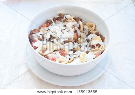 fantastic stuffed porcelain cup of cereal fruit and coconut flakes