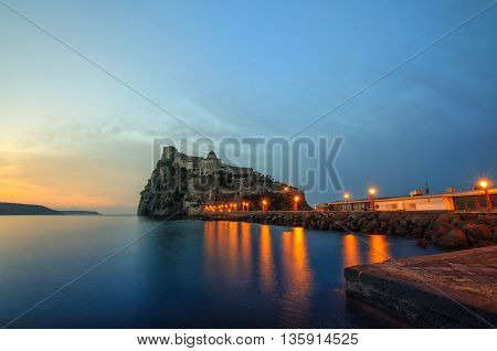 Aragonese castle at sunrise. Mediterranean Sea coast bay of Naples Ischia island Italy