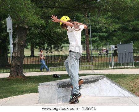 Skateboarder Jumping Onto Wall