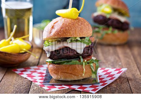 Beef burger with vegetables, hot pepper and cheese