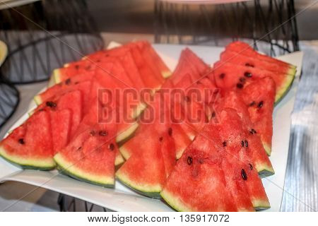 close up piece of watermelon in the buffet line