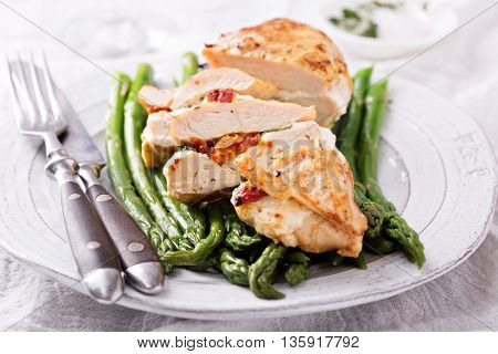 Grilled chicken breast stuffed with mozzarella and tomatoes