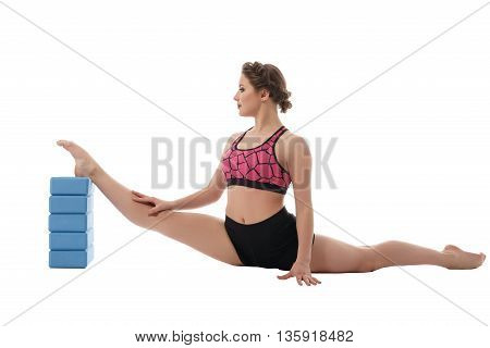 Gymnastics. Woman exercising with bricks for stretching
