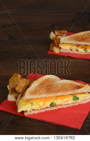 top view omelette sandwich with home fries