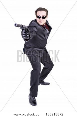 Elegant gangster ready to shoot isolated on white background.