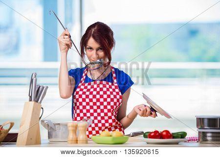 Woman preparing soup in the kitchen