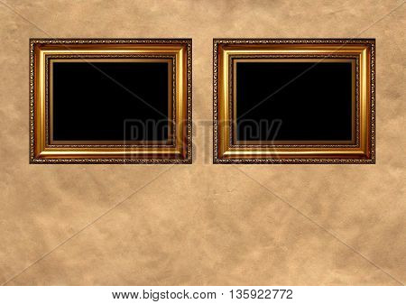 Two antique golden frames with black copy space on vintage background