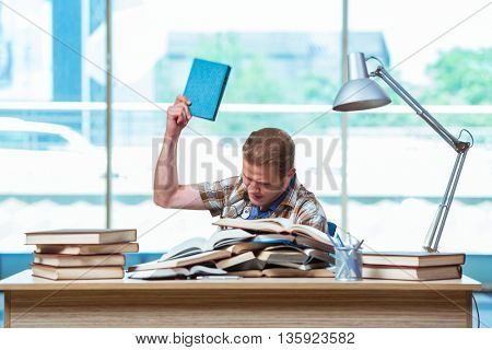 Young male student preparing for high school exams